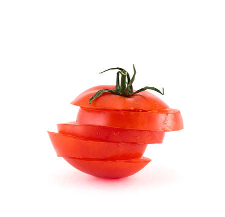Red tomato sliced into five segments isolated over white background