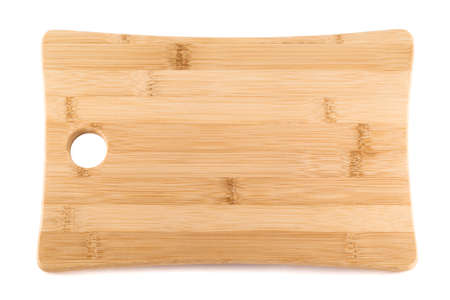 Wooden cutting board isolated over white background photo