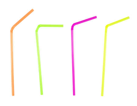 Set of four colorful plastic bent drinking straws isolated over white background