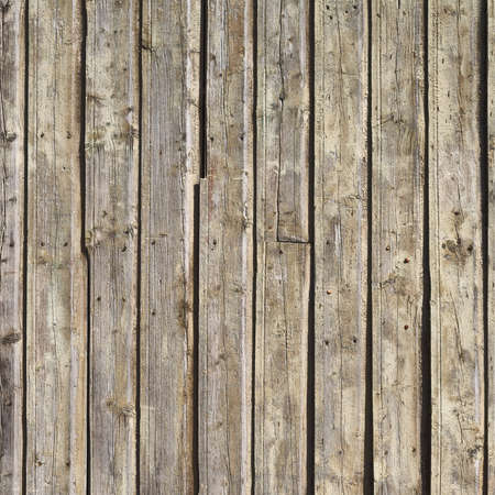 Outdoor photo of old wood plank wall surface as abstract texture background
