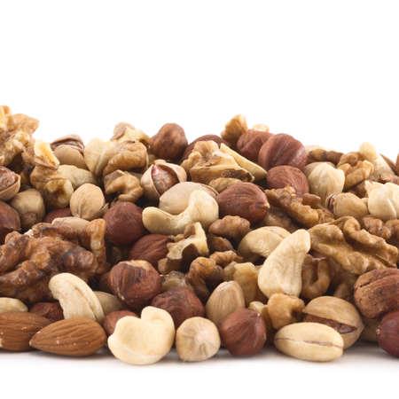 Almond, pistachio, peanut, walnut, hazelnut mixed pile as a background composition photo