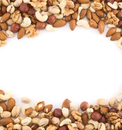 Almond, pistachio, peanut, walnut, hazelnut mix copyspace frame background photo