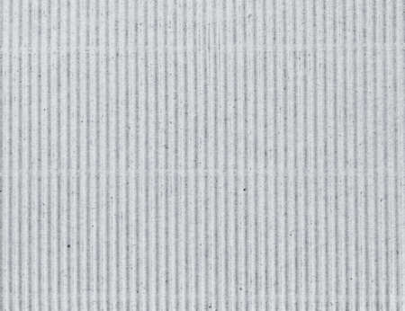 Photo of corrugated grey cardboard as abstract background front view