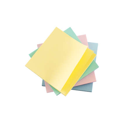Pile of post-it sticky note papers composition isolated over white background photo