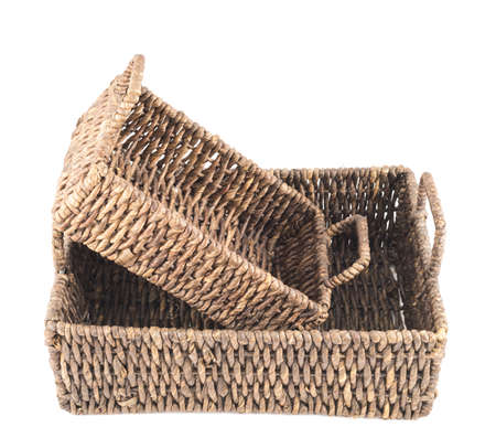 double reed: Composition of two brown wicker baskets, box shaped, isolated over white background