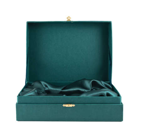 Opened green silk case box with a satin cloth inside isolated over white background, front view photo