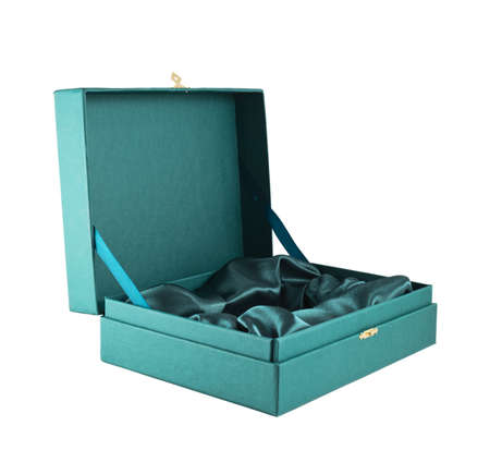 Opened green silk case box with a satin cloth inside isolated over white background, side view photo