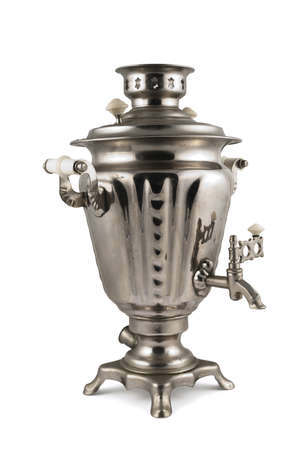 Old russian samovar metal water boiler isolated over white background