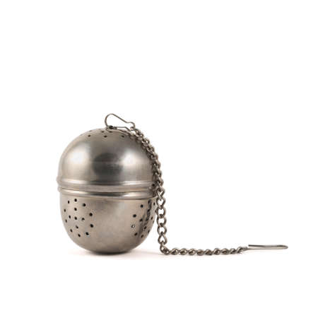 infuser: Metallic tea strainer infuser isolated over white background