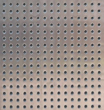 쇠 격자: 추상적 인 배경으로 구멍 금속 표면 질감