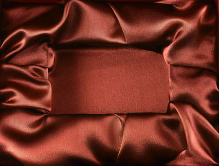 gift packs: Photo of silk opened box as texture background top view