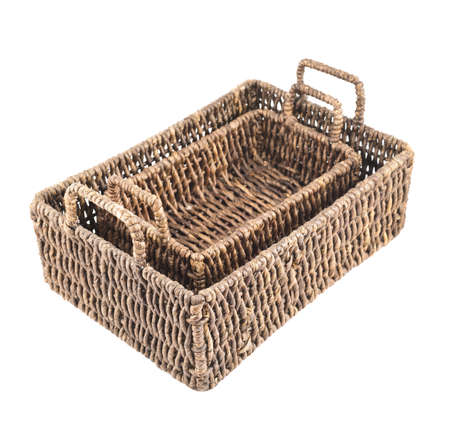 Composition of two brown wicker baskets, box shaped, isolated over white background photo