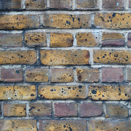 soot: Covered with the soot brick wall as abstract background Stock Photo