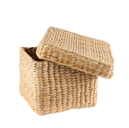Box shaped wicker basket with a cover cap isolated over white background photo