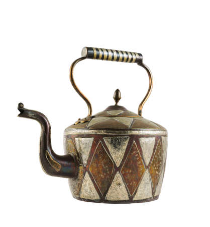Authentic metal teapot vessel covered with ornaments isolated over white background photo