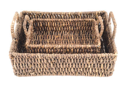 wickerwork: Composition of two brown wicker baskets, box shaped, isolated over white background, top view Stock Photo