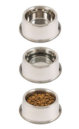 Set of three pets dog metal bowls filled with dry food, water and empty isolated over white background photo