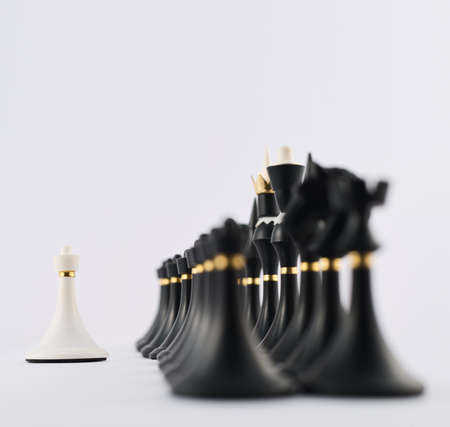 White chess pawn figure opposite to the black ones composition photo