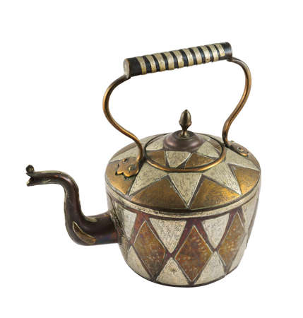 Authentic metal teapot vessel covered with ornaments isolated over white background Stock Photo - 20494295