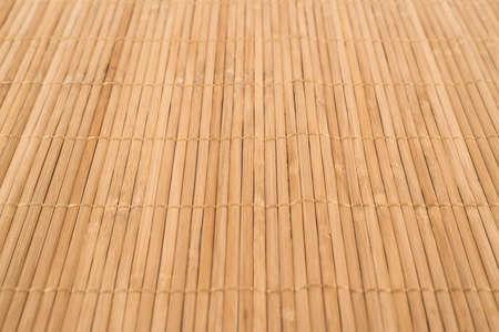 Bamboo brown straw mat as a background composition with a shallow depth of field photo