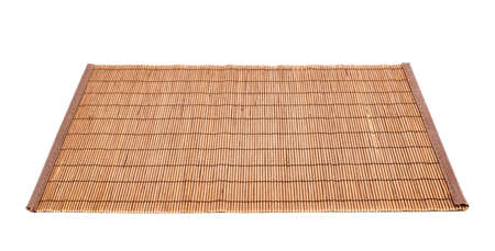 Bamboo brown straw serving mat isolated over white background Reklamní fotografie - 20496844
