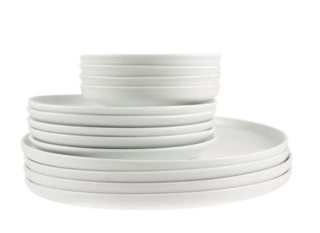Accurate pile stack of the round ceramic empty white dish plates isolated over white background Stock Photo