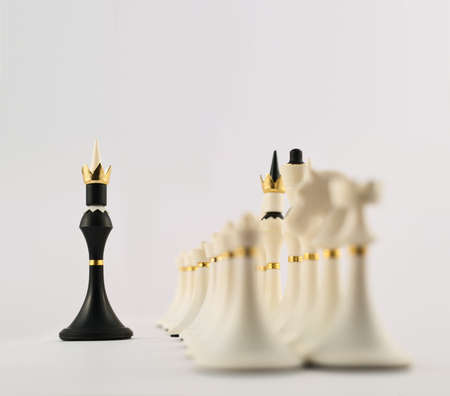 Negotiations concept as black chess king figure opposite to the white ones composition photo