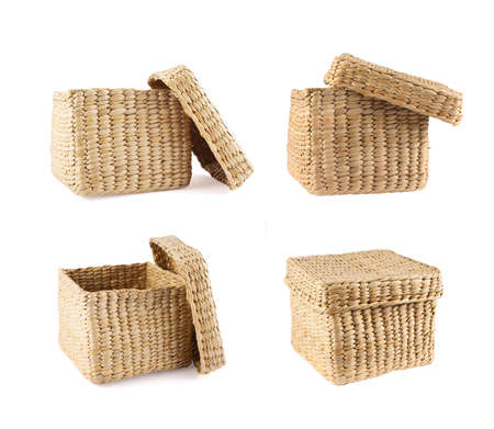 Box shaped wicker basket with a cover cap isolated over white background, set of four foreshortenings photo