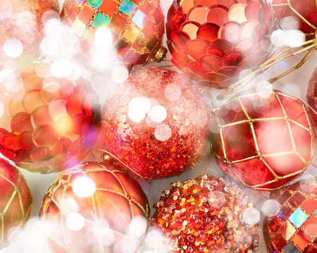Festive Christmas background of xmas balls and decorations under defocused bokeh effect on the foreground photo