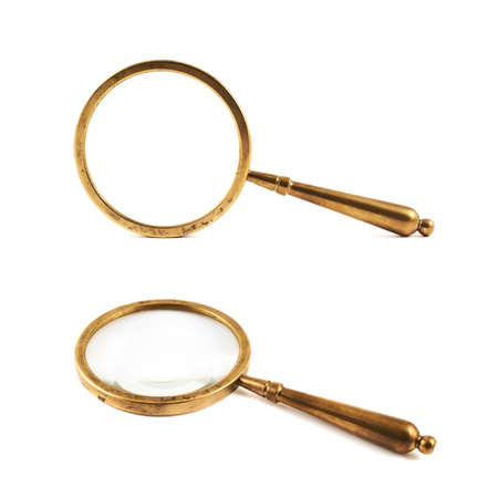 Authentic old metal magnifying glass isolated over white background, set of two foreshortenings Imagens