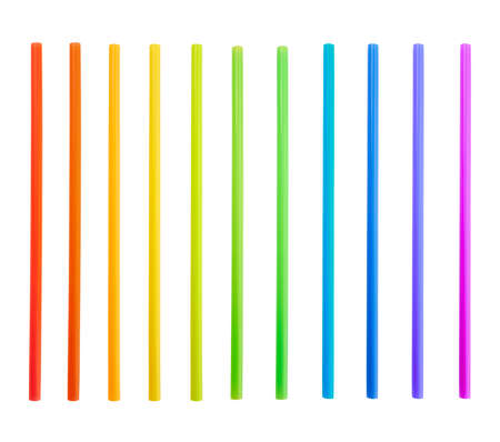 Drinking straw set of rainbow colored plastic tubes isolated over white background photo
