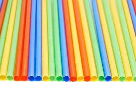 Drinking straw colorful plastic tubes over white as abstract background photo