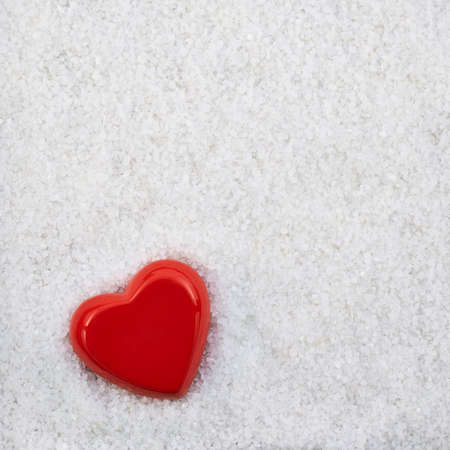 Red heart shape in a white sand copyspace background Stock Photo - 21021188