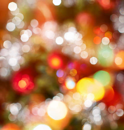holiday garland: Festive Christmas background of defocused decorated xmas tree bokeh composition Stock Photo