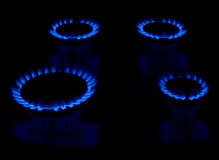 Gas stove as a blue fire lights in the dark Stock Photo - 21217880