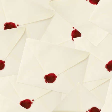 Sealed with the red wax envelopes as a seamless background pattern photo