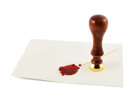 Sealed envelope with a stamp sealing wax press over it, isolated over white background photo