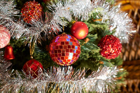 Seasonal Christmas decoration background as a fragment of a decorated with balls xmas tree photo