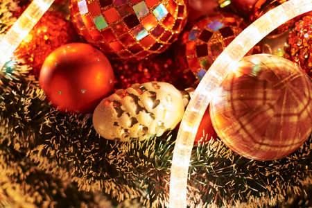 Seasonal Christmas decoration background as a pile of xmas tree decorations photo