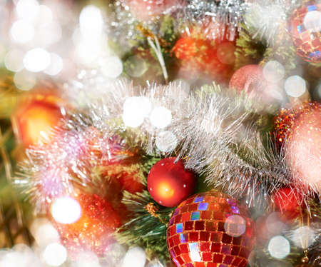 Seasonal Christmas decoration background as a fragment of a decorated christmas tree covered with bokeh light effect photo