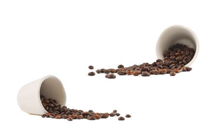 coffee spill: Spilled coffee beans from the white ceramic cup isolated over white background, set of two foreshortenings