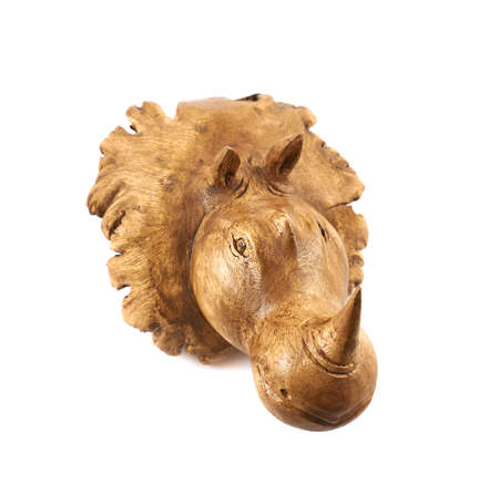 Rhinoceros rhino sculpture made of carved brown wood isolated over white background photo
