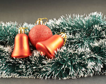 Seasonal Christmas decoration background as an xmas tree garland fragment covered with decorations photo