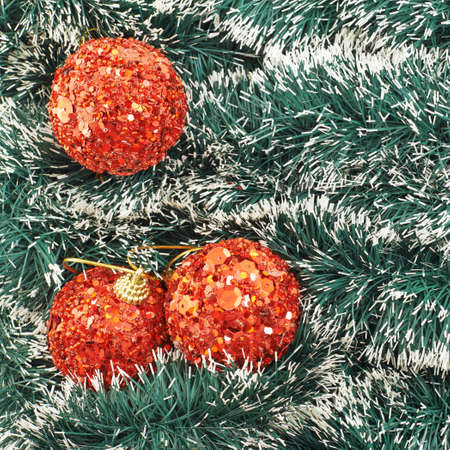 Seasonal Christmas decoration background as an xmas tree garland fragment covered with decorational balls photo