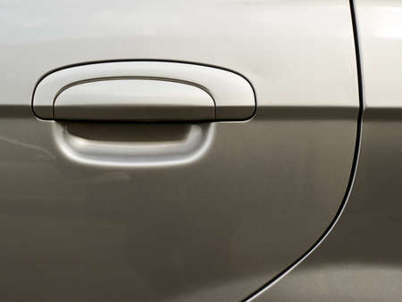 Silver metallic car's door fragment with a handle Stock Photo - 21792086