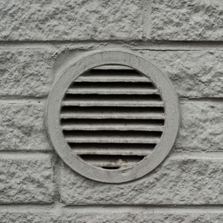 Concrete drain lattice or ventilation element in the wall photo