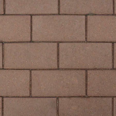pave: Brown brick paving stone sett as abstract background texture