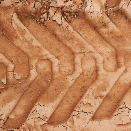 Wheel's trail tread in the red mud as a background Stock Photo - 21871635