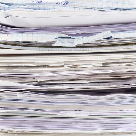 Stack of paper sheets and documents fragment as a business background Stock Photo