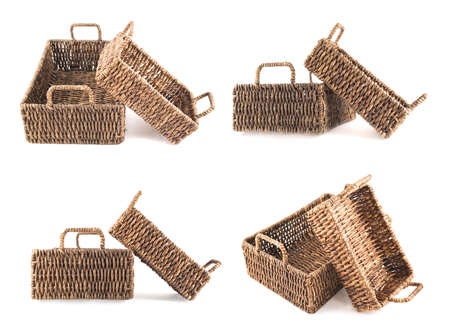 double reed: Composition of two brown wicker baskets, box shaped, isolated over white background, set of two foreshortenings Stock Photo